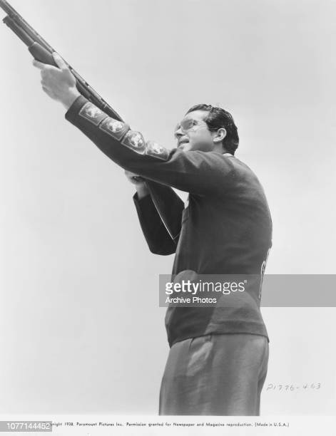 American actor Fred MacMurray proves himself an adept marksman in a skeet shooting contest 1938 He is indulging his hobby between takes of the...
