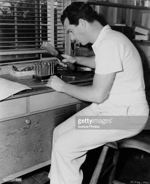 American actor Fred MacMurray pursues his hobby of woodwork with a set of precise tools USA 1941