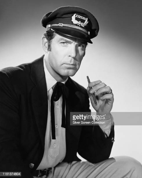 American actor Fred MacMurray wearing a Captain's cap in a publicity shot for the film 'Fair Wind To Java' 1953