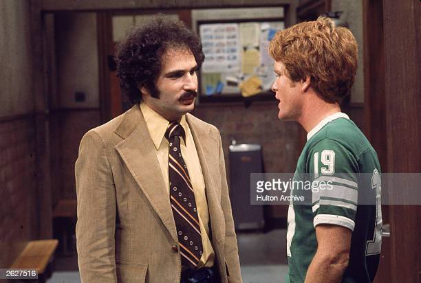 American actor Gabe Kaplan speaks to an unidentified actor in a still from the television series 'Welcome Back Kotter' 1977