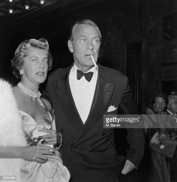 American actor Gary Cooper and his wife Sandra Shaw attend the premiere of director George Cukor's film 'A Star is Born' Hollywood California Cooper...