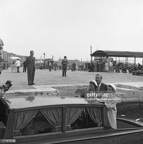 American actor Gary Cooper, his wife Veronica and his daughter Maria, standing on a water taxi in Riva degli Schiavoni, Venice, 1955.