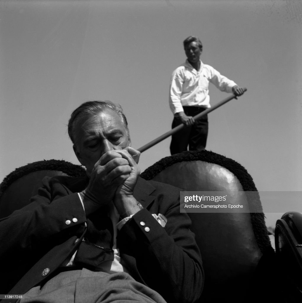 American actor Gary Cooper on a venitian gondola lighting a cigarette the gondolier & In Focus: Glamorous Gondola Rides Photos and Images | Getty Images azcodes.com