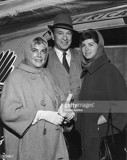 American actor Gary Cooper smiles with his wife Sandra Shaw and his daughter Maria as they prepared to board a flight to Los Angeles en route from a...
