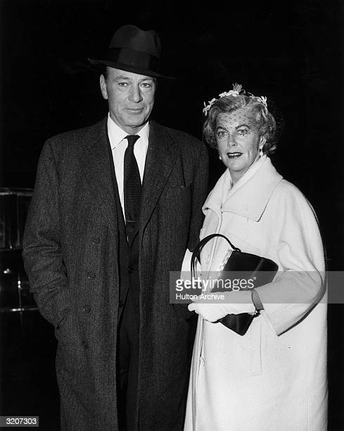 American actor Gary Cooper standing with his wife 'Rocky' actor Sandra Shaw at the premiere of director Delmer Daves's film 'The Hanging Tree' in...