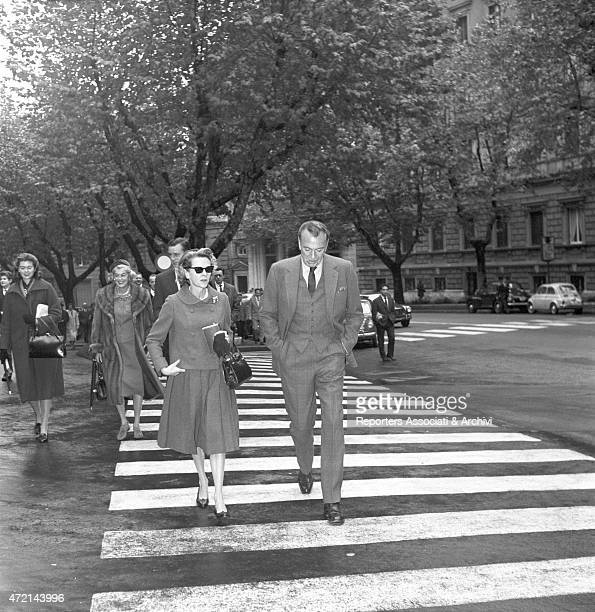American actor Gary Cooper walking on via Veneto, in Rome, with his wife Veronica Balfe. Behind them, their daughter Maria Cooper and some other...