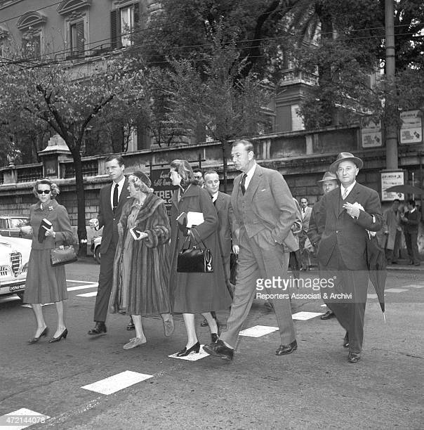 American actor Gary Cooper walking on via Veneto in Rome with his wife Veronica Balfe Behind them their daughter Maria Cooper and some other people...