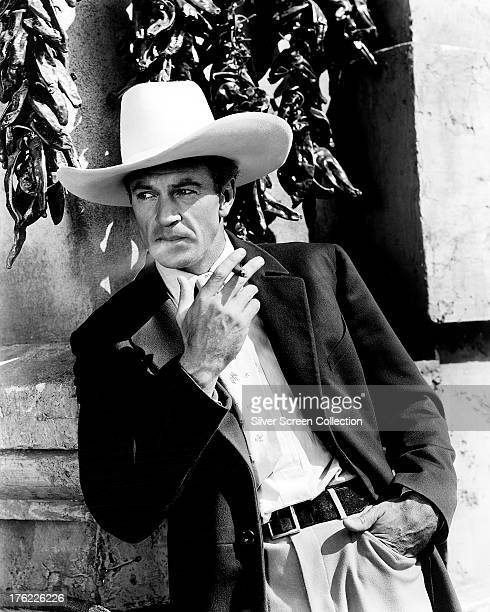 American actor Gary Cooper wearing a large, white stetson, circa 1940.
