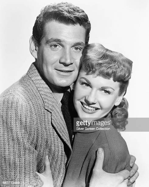 American actor Gene Barry as Dr Clayton Forrester and actress Ann Robinson as Sylvia Van Buren in the science fiction film 'The War of the Worlds'...