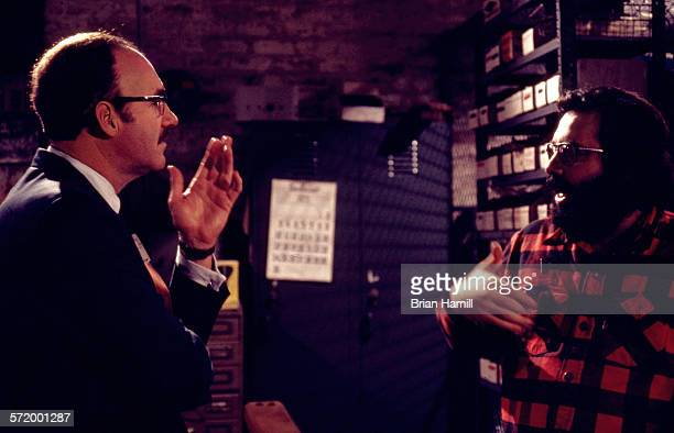 American actor Gene Hackman and director Francis Ford Coppola discuss a scene on the set of their film 'The Conversation' 1978