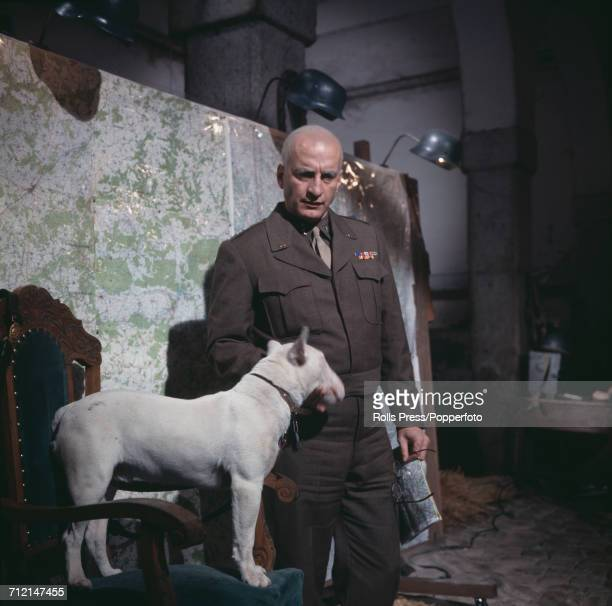 American actor George C Scott pictured dressed in character as General George S Patton, Jr with a bull terrier dog as Willie on the set of the film...