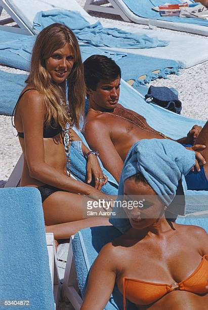 American actor George Hamilton relaxes on a deckchair in Capri 1968