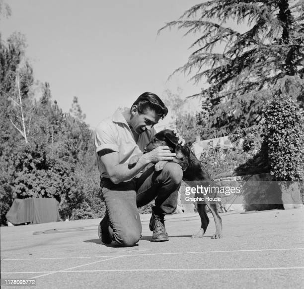 American actor George Nader with his dog circa 1955