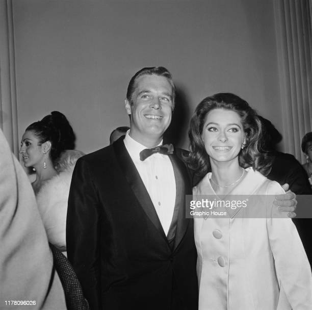 American actor George Peppard and his wife, actress Elizabeth Ashley at the premiere of the film 'The Sand Pebbles', 1966.