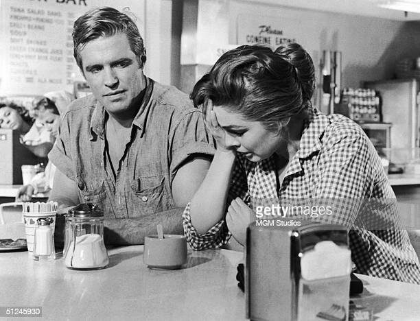 American actor George Peppard and Luana Patten , sit together in a still from the film 'Home from the Hill' directed by Vincente Minnelli.