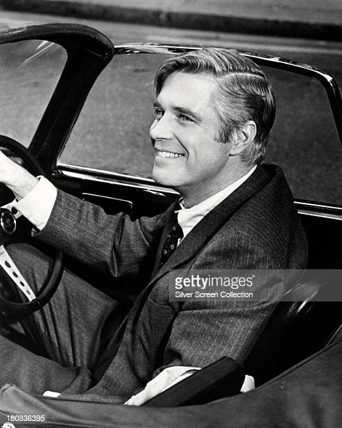 American actor George Peppard as John Shay at the wheel of a Lotus sports car in 'The Executioner' directed by Sam Wanamaker 1970
