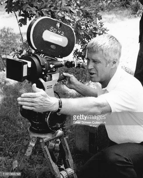 American actor George Peppard as Thomas Banacek adjusting an Arriflex camera on the set of the television series 'Banacek' circa 1973