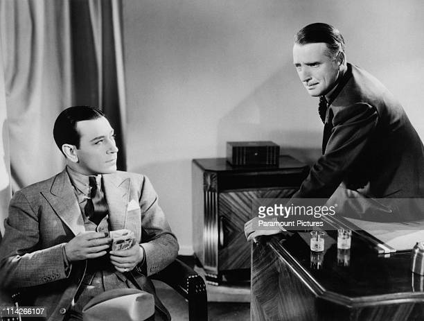 American actor George Raft as Ed Beaumont and Robert Gleckler as Shad O'Rory in a scene from 'The Glass Key' directed by Frank Tuttle 1935 The film...