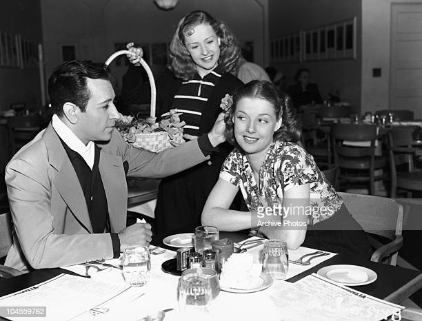 American actor George Raft and American actress Ann Sheridan at a restaurant circa 1940s