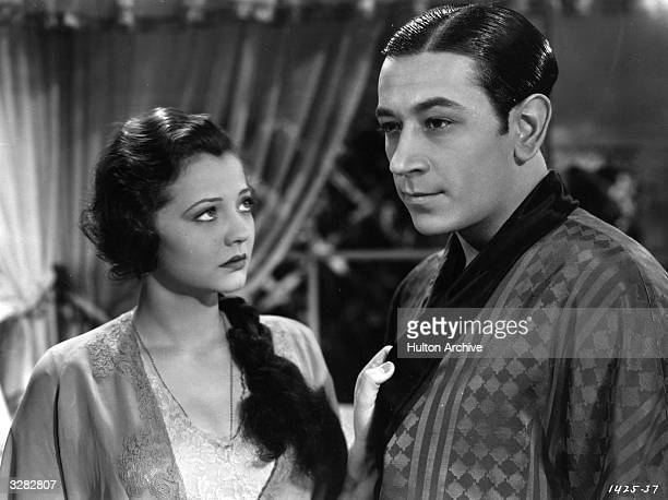 American actor George Raft turns away from Sylvia Sidney , the screen name of Sophia Kosow the American actress, in a scene from 'Pick-Up', directed...