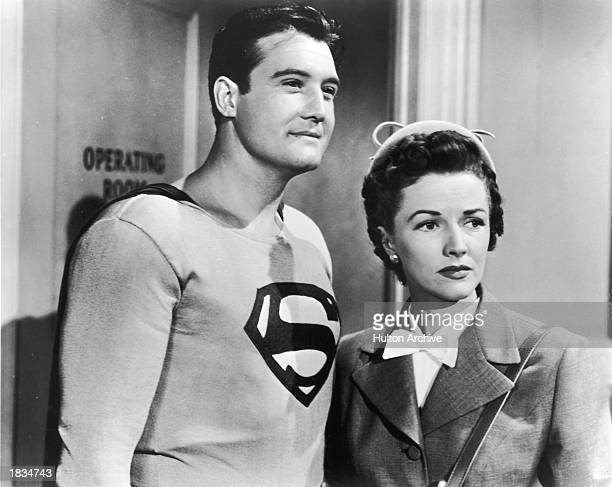 American actor George Reeves as Superman stands with Phyllis Coates as Lois Lane in a still from the television series 'Adventures of Superman' c 1952