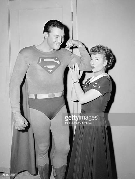 American actor George Reeves flexes his bicep while actress and comedian Lucille Ball touches his muscle during the episode 'Lucy and Superman' of...