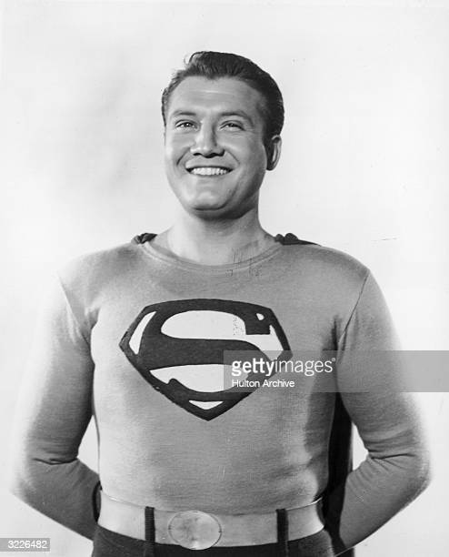 American actor George Reeves smiling in costume as Superman in a promotional portrait for the television series 'Adventures of Superman'