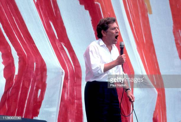 American actor George Segal speaks from the stage during the Live Aid benefit concert at Veteren's Stadium Philadelphia Pennsylvania July 13 1985