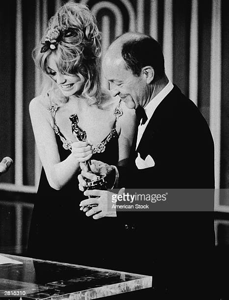 American actor Goldie Hawn presents the Best Actor Oscar to Frank McCarthy, accepting on behalf of George C. Scott for his role in the film,...