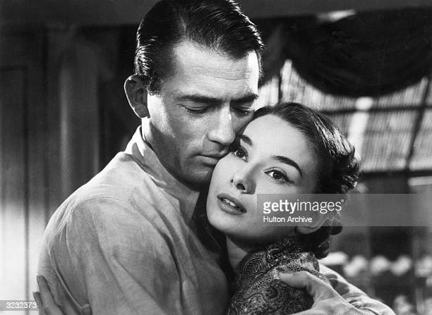 American actor Gregory Peck and Belgianborn actress Audrey Hepburn embrace in a still from director William Wyler's film 'Roman Holiday'