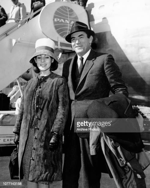 American actor Gregory Peck and his wife Veronique arrive at New York International Airport from the UK, 31st March 1963. They had just watched their...