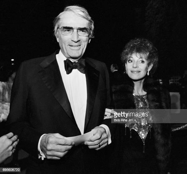 American actor Gregory Peck and his wife Veronique Peck arrive at the Cinerama Dome for the premiere of the film 'Yentl' Los Angeles California...