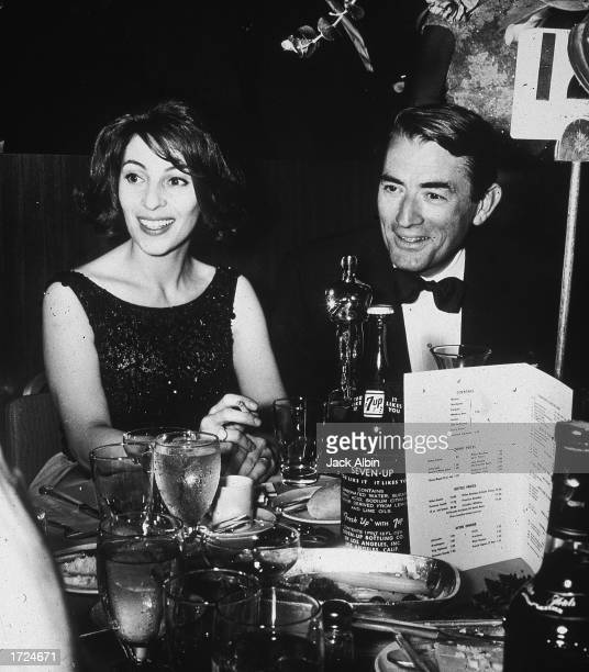 American actor Gregory Peck and his wife, Veronique, sit together at the Academy Awards after party, Santa Monica, California, April 8, 1963. Peck...