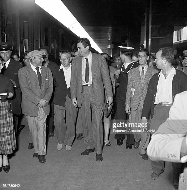 American actor Gregory Peck arriving at Termini station with American director William Wyler Rome 1954
