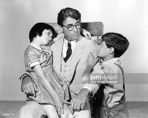 American actor Gregory Peck as Atticus Finch with Mary Badham as Scout and Phillip Alford as Jem in 'To Kill A Mockingbird' directed by Robert...