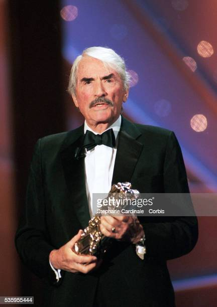 American actor Gregory Peck holds his 'Cesar of Honour' which he was awarded during the 20th Cinema Cesars night in Paris