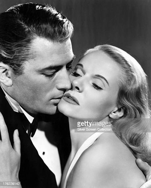 American actor Gregory Peck kisses Italian actress Alida Valli in a promotional portrait for 'The Paradine Case' directed by Alfred Hitchcock 1947