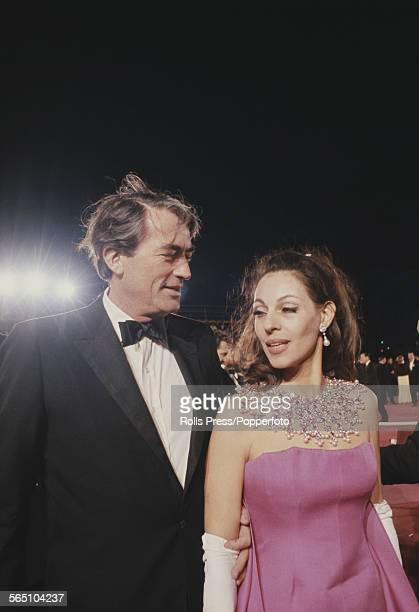 American actor Gregory Peck pictured with his wife Veronique Passani attending the 39th Academy Awards at the Santa Monica Civic Auditorium in...