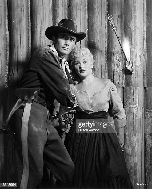 American actor Gregory Peck playing the part of a cavalry officer alongside Barbara Payton in 'Only The Valiant'
