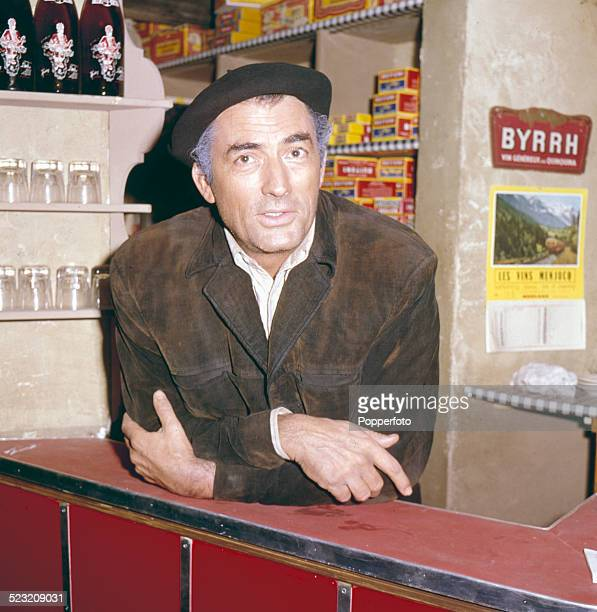 American actor Gregory Peck posed behind a bar in character as Catalan guerilla Manuel Artiguez during the production of the film Behold a Pale Horse...