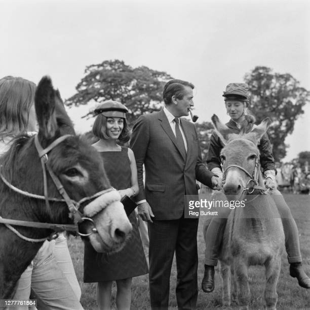 American actor Gregory Peck with his wife Veronique at the summer fete in Shipbourne, UK, 11th June 1966.