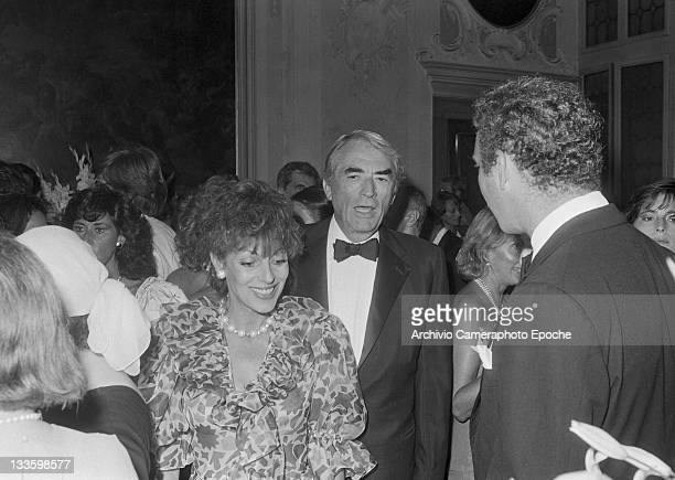 American actor Gregory Peck with his wife Veronique Peck in Venice for the 'Tribute to Ingrid' celebration, Lido, Venice, 1983.