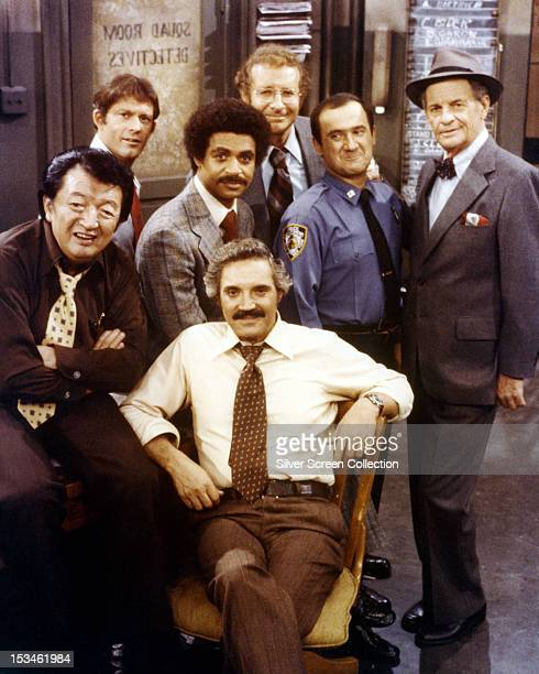 American actor Hal Linden as Captain Barney Miller with the cast of the American TV police comedy series 'Barney Miller' circa 1978 Other cast...