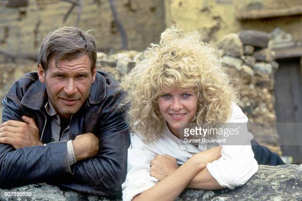 "American actor Harrison Ford and actress Kate Capshaw on the set of ""Indiana Jones and the Temple of Doom""."