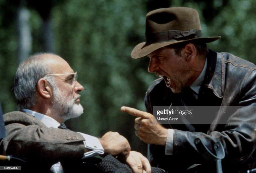 American actor Harrison Ford as the eponymous archaeologist and Scottish actor Sean Connery as his father Henry Jones during the motorcycle chase scene from the film 'Indiana Jones and the Last Crusade', 1989.