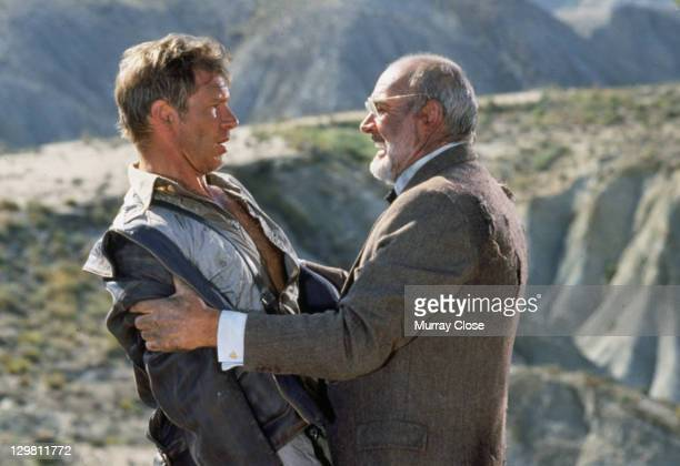 American actor Harrison Ford as the eponymous archaeologist and Scottish actor Sean Connery as his father Henry Jones in a scene from the film...