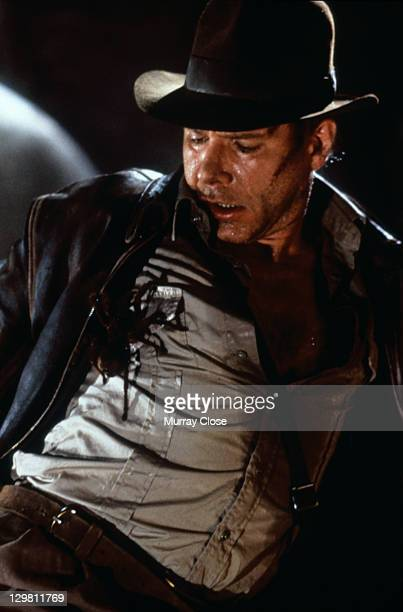 American actor Harrison Ford as the eponymous archaeologist facing a large spider in a scene from the film 'Indiana Jones and the Last Crusade' 1989...