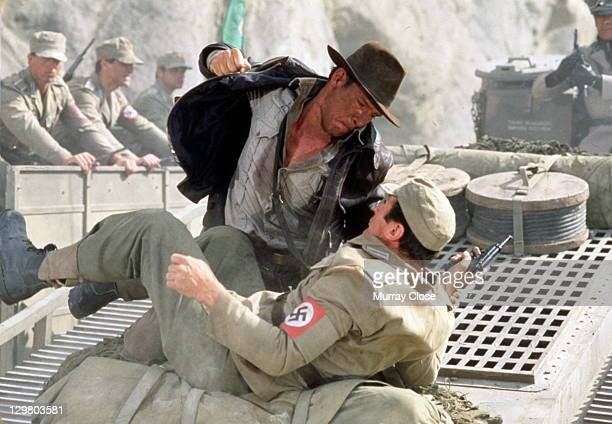 American actor Harrison Ford as the eponymous archaeologist in a scene from the film 'Indiana Jones and the Last Crusade' 1989 Here he has a...