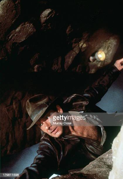 American actor Harrison Ford as the eponymous archaeologist in a scene from the film 'Indiana Jones and the Last Crusade' 1989 Here he hangs from the...