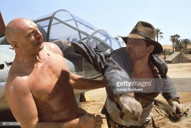American actor Harrison Ford on the set of Raiders of the Lost Ark